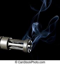 smoking barrel - A2 flash hider on an assault rifle blowing...