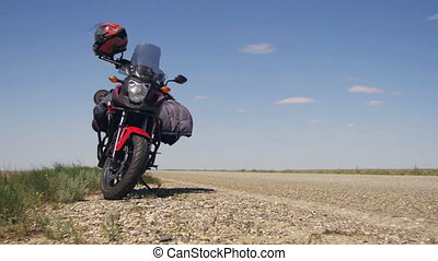 Moto Travel. Motorcycle Stands near the Road and Passing...