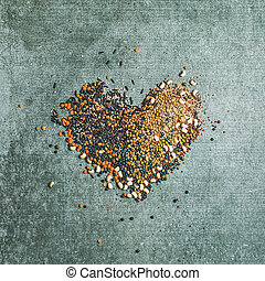 Various raw grains, beans, cereals in shape of heart
