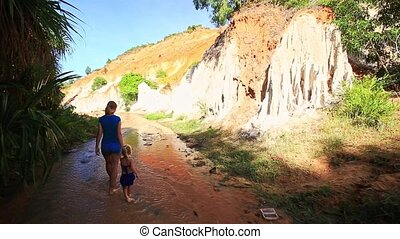 Mother Little Girl Walk along Water Stream to Steep Cliff -...