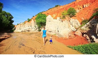 Mom Little Daughter Walk in Water to High Long Cliff -...