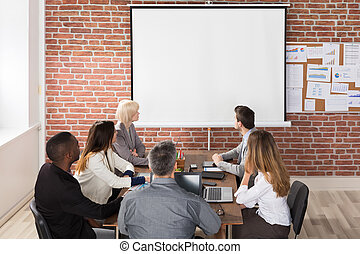 Businesspeople Looking At Presentation
