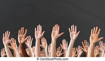 Close-up Of Raised Hands - Crowd Raising Hands High Up On...