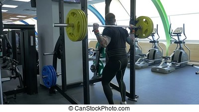 Young shirtless man doing deadlift exercise at gym....