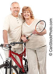 Active elderly couple Isolated over white background