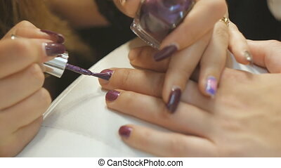 Makeup artist backstage. Closeup shot of painting nails.