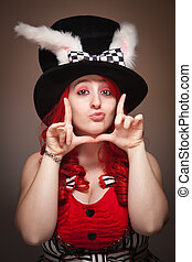 Attractive Red Haired Woman Wearing Bunny Ear Hat Framing Face
