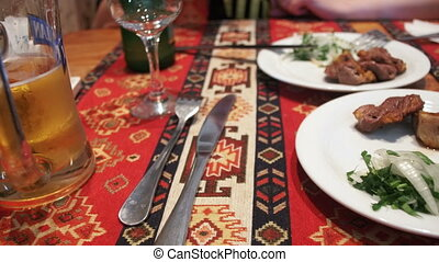 Shish Kebab on a Plate in a Restaurant - Shish kebab on a...