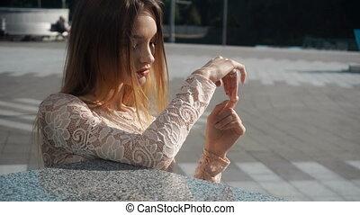beautiful blonde woman looks at the camera