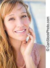 Outdoor Portrait of Young Adult Brown Eyed Woman.