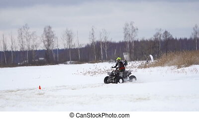 ATV race in the winter season. - ATV race on the snow. Rider...