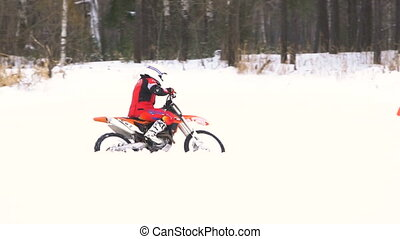Winter motorcycle race. - Motorcycle rider on snowy...