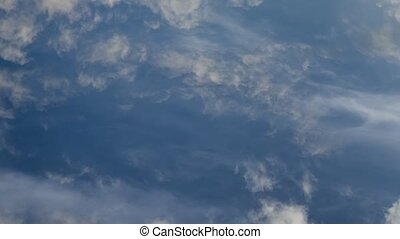 Time lapse video of white cumulus and fleecy clouds morphing...