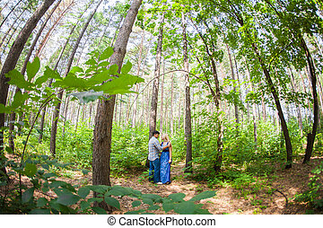 A young sweet couple in love on nature