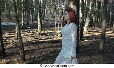 Woman is walking in the forest. - Woman is walking in the...
