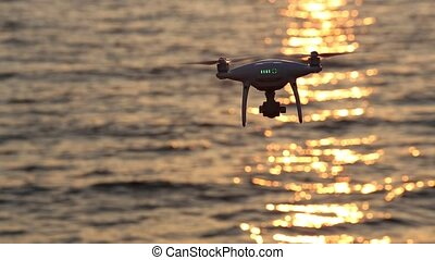drone flying sparkle sunlight on sea