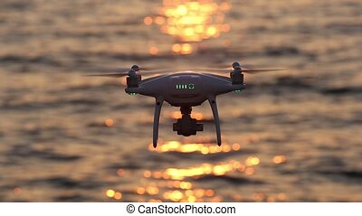 drone flying sparkle sunlight on sea - Remote controlled...