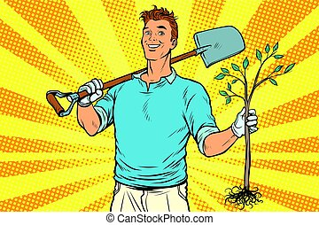 Man gardener with a shovel and sapling