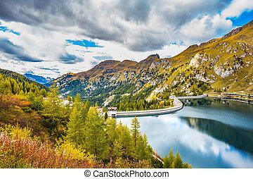 Grandiose glacial lake Lago di Fedaia in the Dolomites....