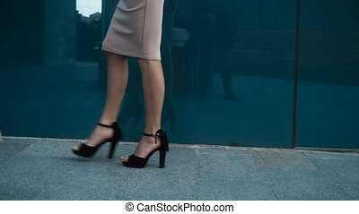 sexy lady on black high heels walks from side to side