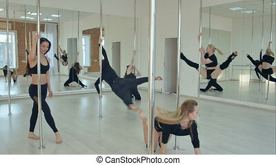 Group of hispanic women stretching and warming up for their pole dancing class