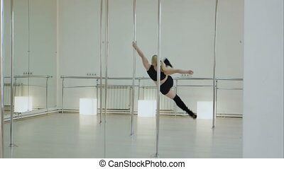 Improbable pole dancer makes a split while hangs upside down...