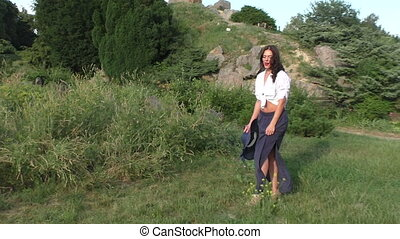 Woman is smiling and spinning in the field. - Woman smiling...