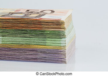 many different euro bills. photo icon for wealth and...