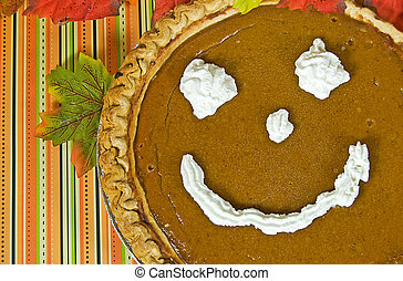 Happy Face - Happy face on a pumpkin pie.