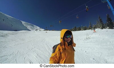 Woman Descent on skis from the snow mountains - Dynamic...