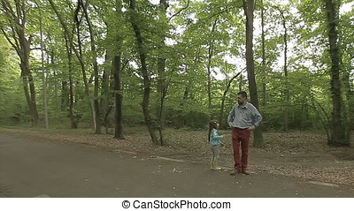 Daughter Asking Father along Road in Forest Wide Shot -...