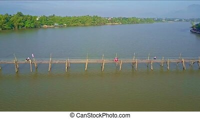 Aerial View River with Wooden Bridge and Green Banks