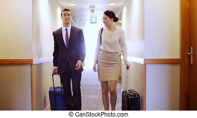 business team with travel bags at hotel corridor - business...