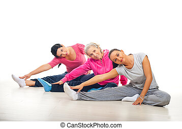 Group of women training - Group of three women training and...