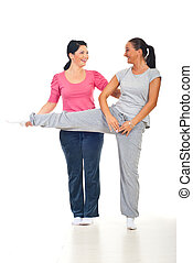 Woman with personal trainer laughing - Woman and her...