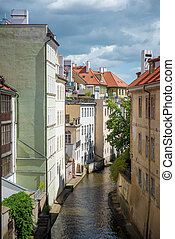 Prague old city - view from the Charles Bridge in the narrow...
