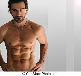 Sexy shirtless man - Sexy athletic shirtless man against...