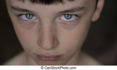 Portrait of a boy close-up - Child portrait, boy looks at...