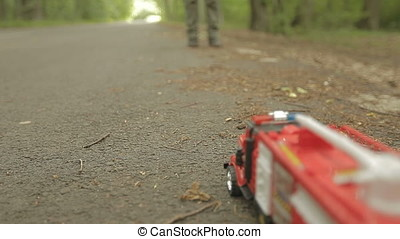 Little Girl Pushing Fire Engine Toy Car - Little girl...