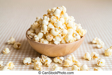 caramel popcorn on table - caramel popcorn in bowl on the...