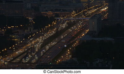 Timelapse. Very intense traffic on the streets of the city....