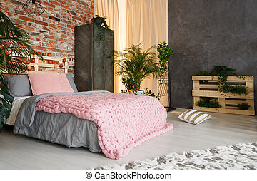 Feminine bedroom space in multifunctional, spacious studio