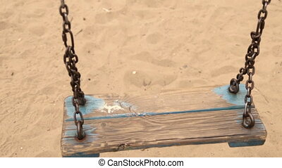 Swing on the playground - An empty swing on the playground