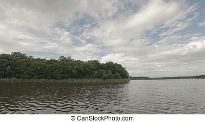Cloudy Sky Forest Pond - Cloudy sky forest pond. Focus on...
