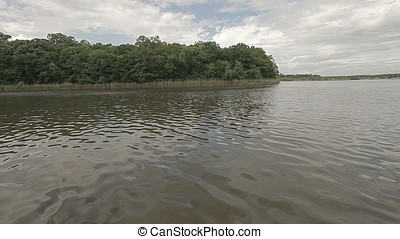 Cloudy Sky over Forest Lake - Cloudy sky over forest lake....