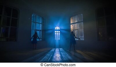 Dance theater performed by two girls in the moonlight, silhouette