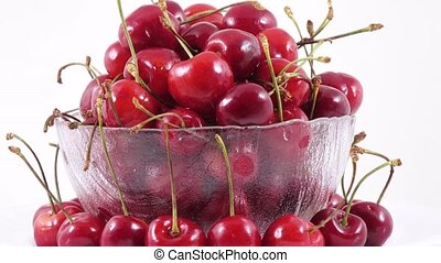 Berries of sweet cherry - Rotation of a glass bowl with...