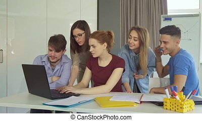 Young people show teamwork at the office