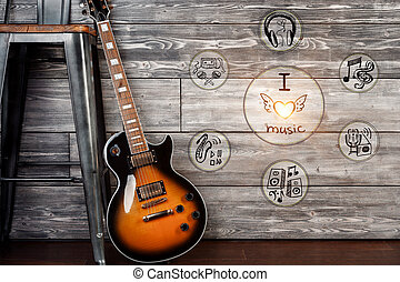 Music concept - Electric guitar in wooden room with creative...