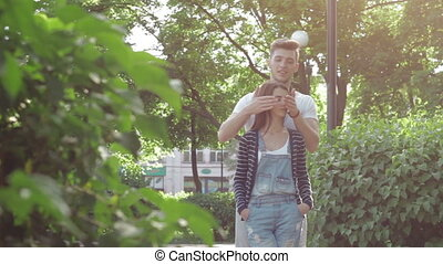 young romantic couple in love outdoors in the park